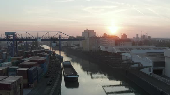 Thumbnail for Port Warehouses and Cargo Loading Cranes in Beautiful Morning Sunlight, Aerial Forward Crane Up Slow