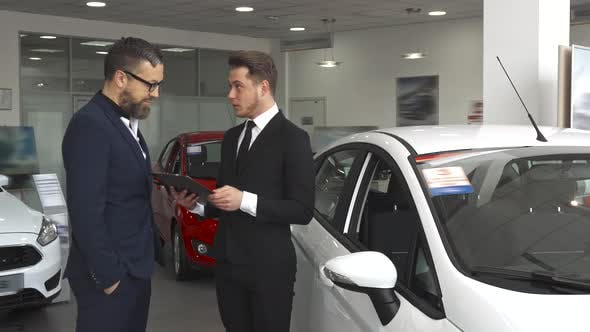 Thumbnail for Sales Manager Explaines the Contract To the Customer at the Car Dealership