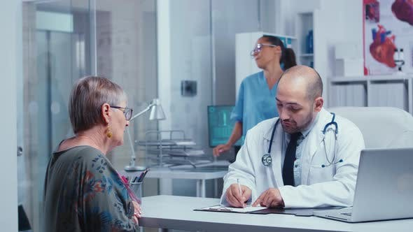 Thumbnail for Physician Consulting an Elderly Retired Woman