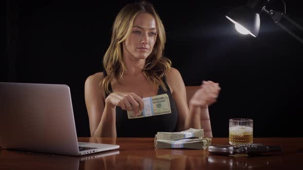 Sexy woman with a stack of money