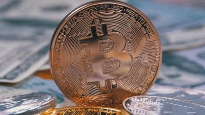 Bronze Bitcoin Coin, BTC and Bills of Dollars Are Rotating