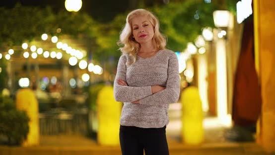 Thumbnail for Beautiful Caucasian woman outside at night posing for portrait
