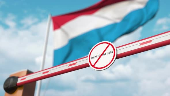 Barrier with No Immigration Sign Opened at Flag of Luxembourg