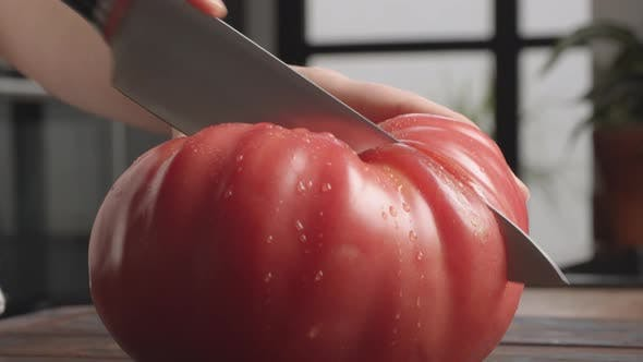 Thumbnail for Cutting Big Juicy Tomato