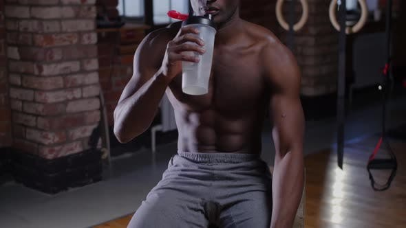 Thumbnail for A Shirtless Africanamerican Handsome Man Training in the Gym  Drinking Water