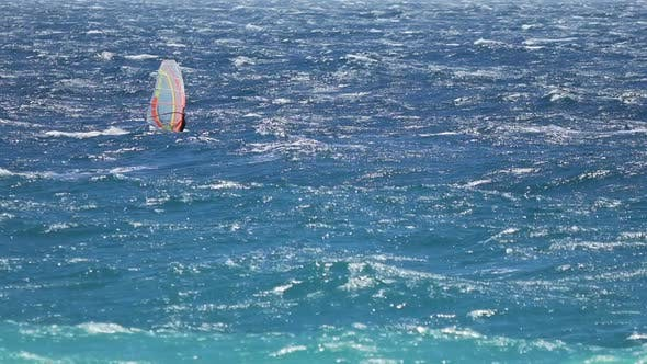 Thumbnail for Light Blue Ocean and Man Windsurfing on Waves, Extreme Sport, Active Lifestyle