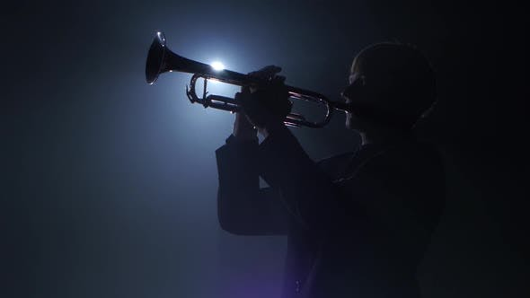 Thumbnail for Trumpeter Plays a Wind Instrument Fast Melody. Studio in Smoke