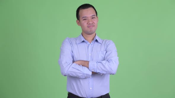 Thumbnail for Studio Shot of Happy Asian Businessman Smiling with Arms Crossed