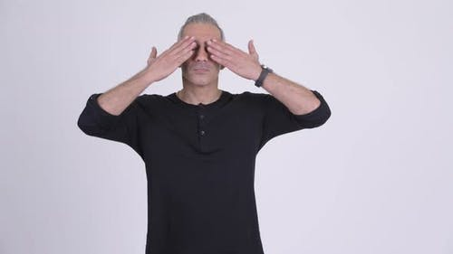 Handsome Persian Man Covering Eyes As Three Wise Monkeys Concept