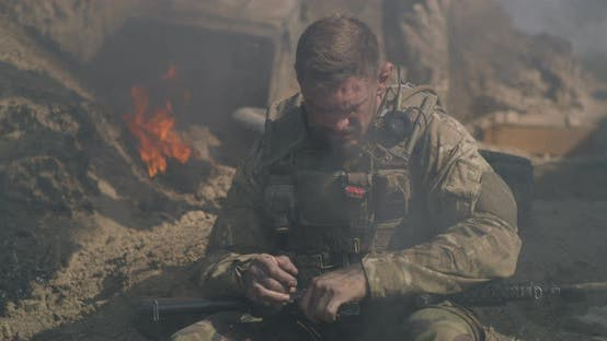 Thumbnail for Tired Soldier Checking Ammo in Rifle