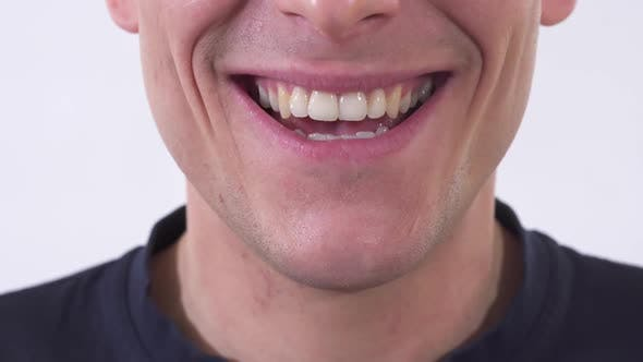 Cover Image for Shooting Mouth of the Mad Man Is Smiling in Wide Unhealthy Smile