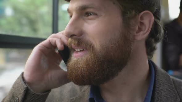Man Talking on Phone during Commute