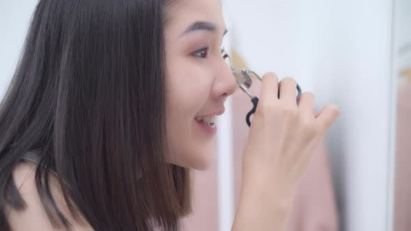 appy female using beauty cosmetics to improve herself ready to working in bedroom at home.