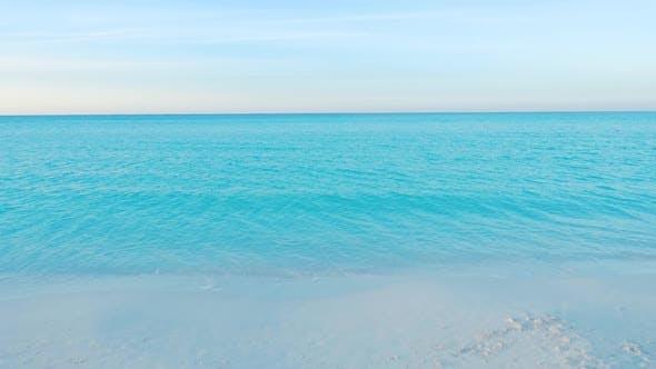 Thumbnail for Moving Towards The Ocean Across A Caribbean Beach At Dusk
