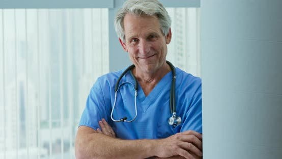 Thumbnail for Happy senior male medical professional looking at camera with smile