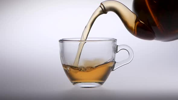 Thumbnail for Tea Is Poured From a Teapot Into Transparent Glass Cup
