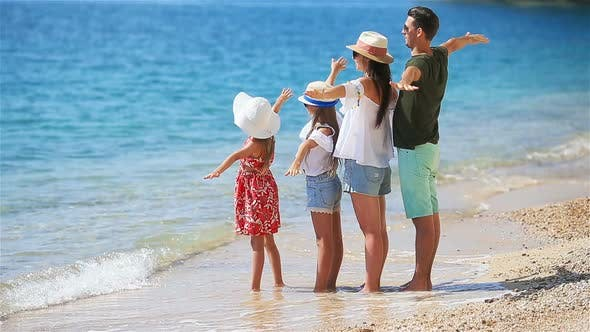 Cover Image for Photo of Happy Family Having Fun on the Beach. Summer Lifestyle