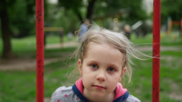 Thumbnail for Little Girl Playing on Playground