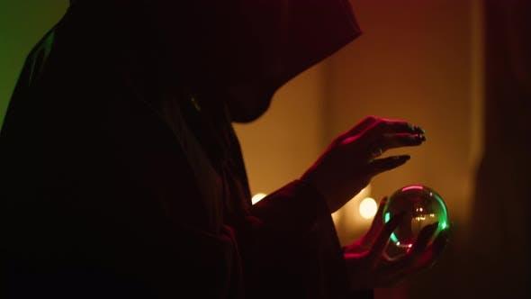 Witch Woman Holding Magic Crystal Ball Closeup
