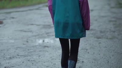 Teenager Walks in Rainy Weather