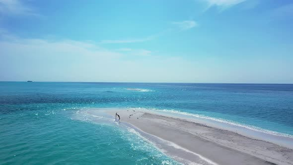 Thumbnail for Wide angle drone copy space shot of a white paradise beach and aqua blue ocean background in colourf