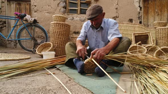 Thumbnail for Hands Man Weaving Basket