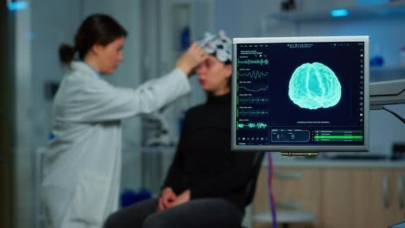 Neurologist Doctor Analysing Nervous System Using Eeg Headset