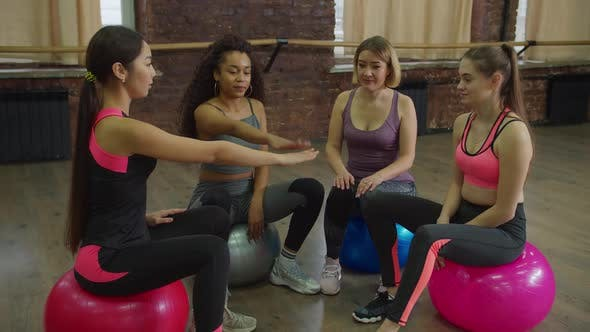 Group of Motivated Fitness Females Stacking Hands