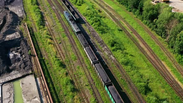 Freight train on the railway. Aerial drone view of freight train