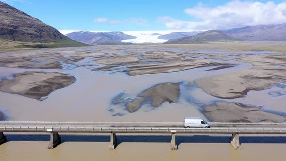 Thumbnail for Flying Above a Car Crossing a Bridge Over a Huge Glacial River in Iceland