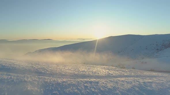 Thumbnail for Mist Floating Above Mountain Hills Covered in Fresh Snow, Sunset Panoramic View