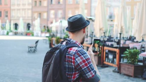 Tourist Making Video Call on Smartphone with Female Tourist From Other Place