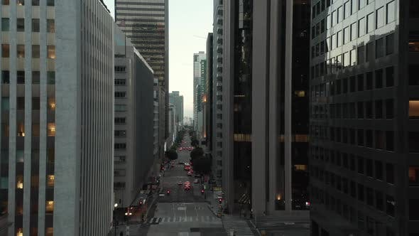 Thumbnail for AERIAL: Epic Flight Through Downtown Los Angeles Skyscraper Canyon in Sunset Light with Car Traffic