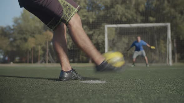 Cover Image for Footballer Scoring a Goal After Penalty Shot