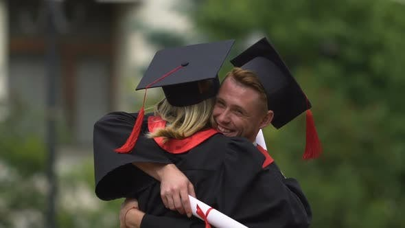 Thumbnail for Happy Man Congratulating and Hugging  Young Woman on Graduation Day, Achievement