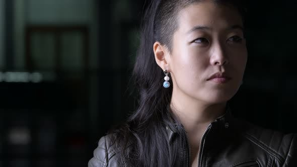 Thumbnail for Face of Beautiful Asian Rebellious Woman Thinking Outdoors at Night