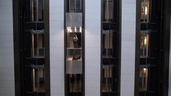View of Hotel Wall with Individual Elevator Cars