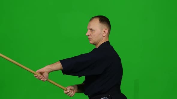 Thumbnail for Masculine Kendo Warrior Practicing Martial Art with the Bamboo Bokken on Green Screen. CLose Up
