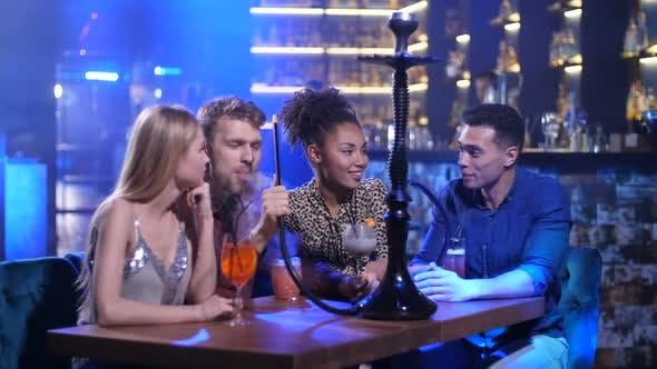 Thumbnail for Happy Friends Talking Smoking Hookah in Nightclub