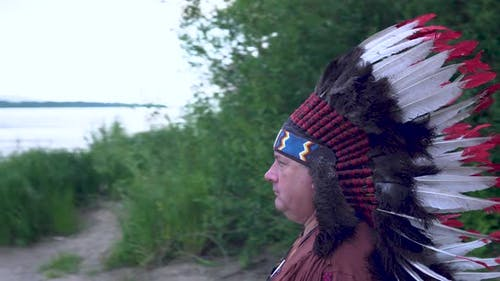 Old Native American Indians Stands on the Background of the River Background of the River.