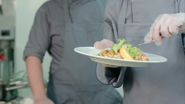 Thumbnail for Young Male Cooks Trying Shrimp Salad