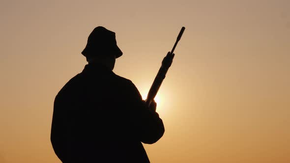 Thumbnail for View From the Back of a Man with a Hunting Rifle
