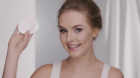 Thumbnail for Woman Wiping Her Face and Showing Cotton Pad to The Camera