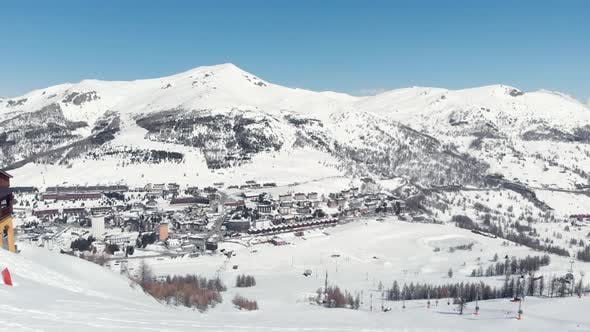 Thumbnail for Sestriere Aerial view from drone, famous snow covered ski resort in the italian Alps