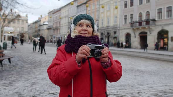 Thumbnail for Senior Woman Grandmother Tourist Taking Pictures with Photo Camera Smiling Using Retro Device