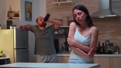 Woman Being Afraid of Drunk Husband