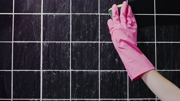 Thumbnail for Close Up Shot of Cleaning the Dirty Tile Wall with Hand in Rubber Glove By Sponge, Commercial of