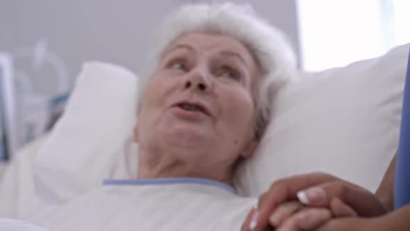 Thumbnail for Nurse Supporting Old Lady in Hospital Ward
