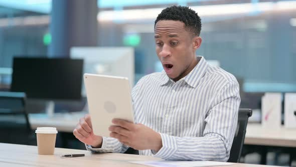 African Businessman Reacting to Loss on Tablet