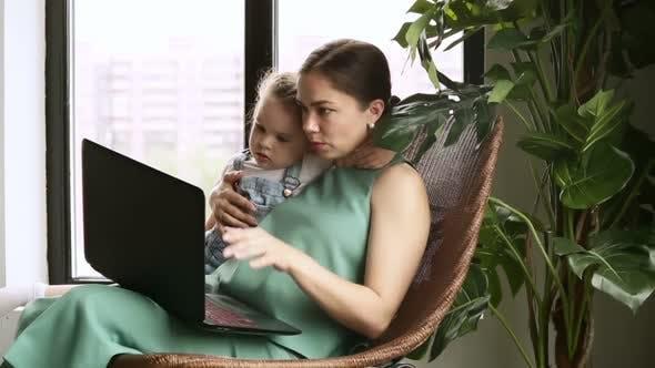 Woman Teaching Child to Use Laptop Device Iroi